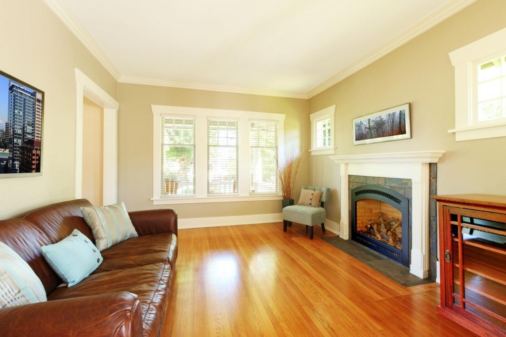 a living room with fireplace